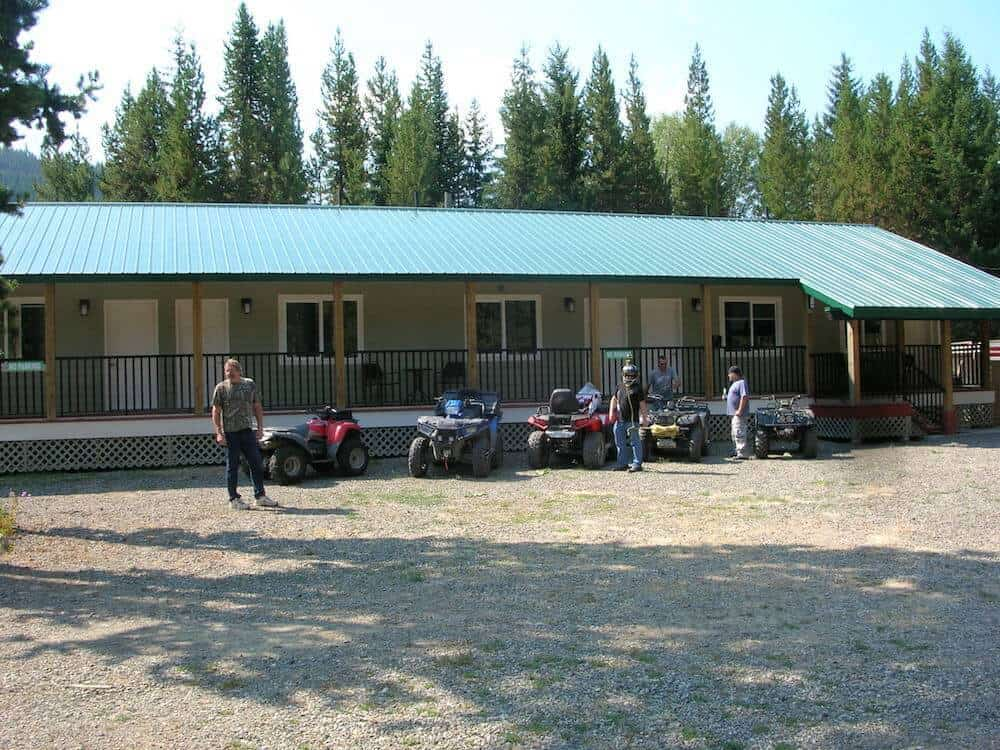 a picture of the guys up getting ready to take off on their atvs